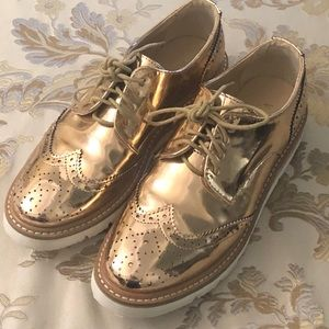 Barely worn rose gold wingtips